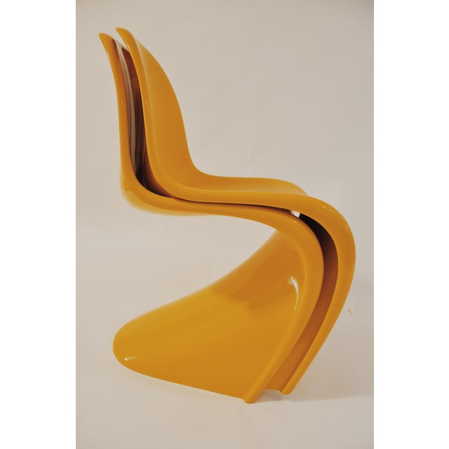 The iconic stacking chair by architect and designer Verner Panton (1926-1998). This chair was the first single-form,...