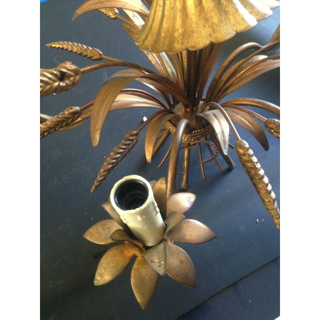 This is a beautiful authentic Maison Bagues gilt tole [antiqued] mid century chandelier, 5 lights. Sheaf of wheat design....