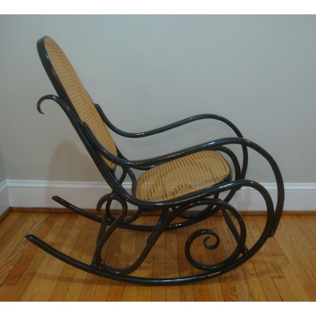 Stunning authentic vintage Thonet bentwood rocker with caned seat and tall back, circa 1960s, possibly earlier. A true...