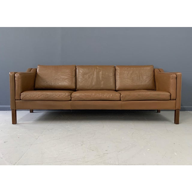 Børge Mogensen three-seat sofa with original brown leather upholstery. Legs of walnut Model 2213, made by Fredericia...
