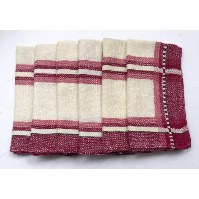 Vintage set of six lightweight woven linen tea-size napkins in ivory, cranberry, maroon, and rose pink. Napkin set has an...