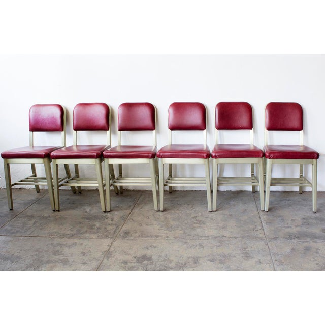 Fantastic set of GoodForm side chairs, circa 1950s. The aluminium frames on these chairs feature an uncommon anodized gold...