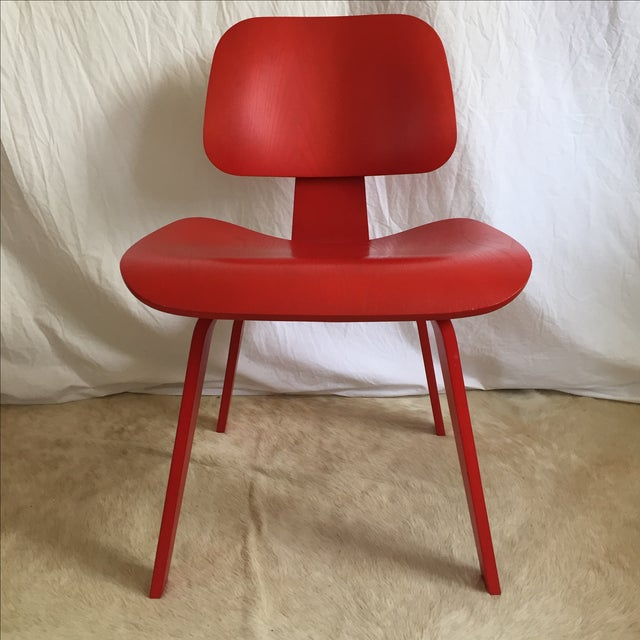 Three classic Eames DCW dining chairs from Herman Miller. 2002 production, original painted finish (not aniline dyed)...