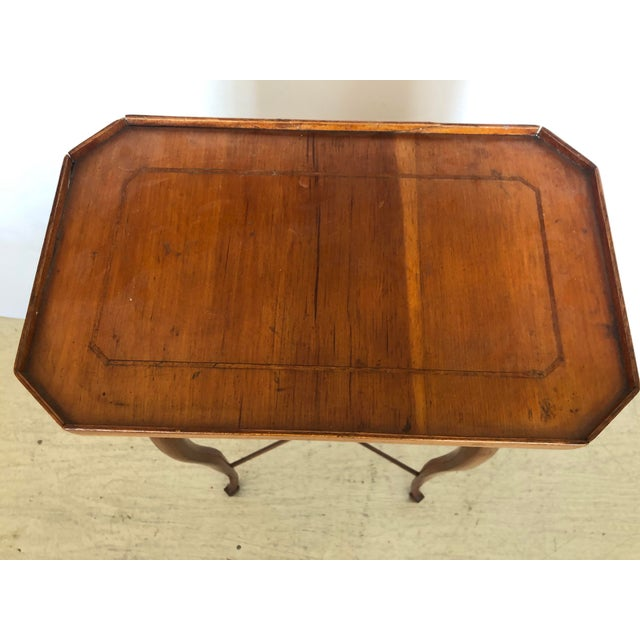 Authentic antique Biedermeier side table or stand having elegant fine silhouette, rectangular top with shallow gallery and...