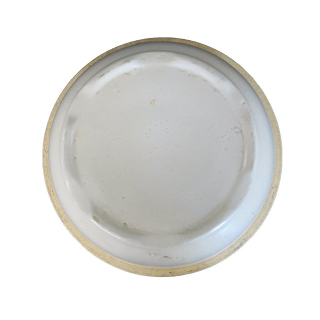 "Antique round off-white stoneware bowl. Measures 10"" across the top and 5"" deep."