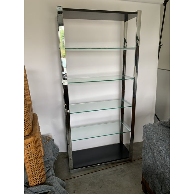 A great alternative to a heavy wood bookshelf to stylize with books, bowls, and decorative items. 4 thick glass shelves...