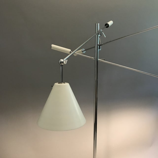 Authentic, original Arredoluce Triennale Lamp. Chrome plated brass with 3 ivory shades. Made in Italy. Adjustable arms...
