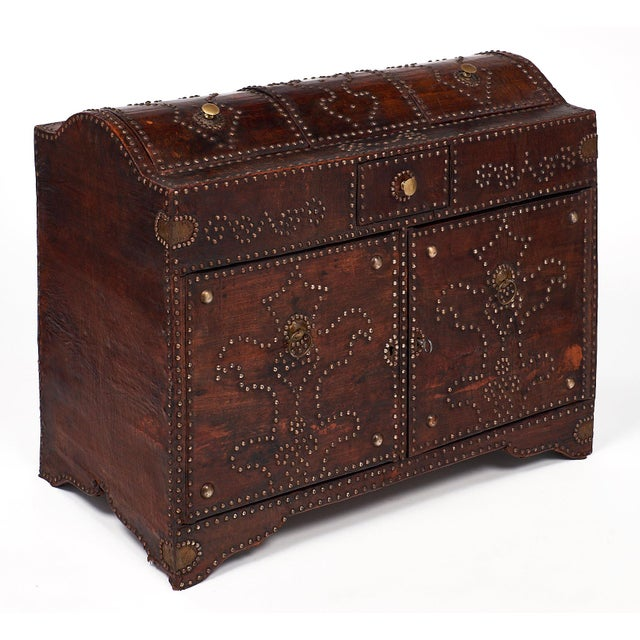 Beautifully intricate wooden trunk wrapped in Moroccan leather and adorned with beautiful designs make of brass studs....