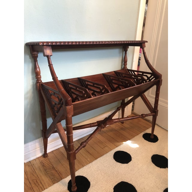 Faux bamboo details on this book trough table. Had x brace stretcher with lots of fretwork in the side panels.