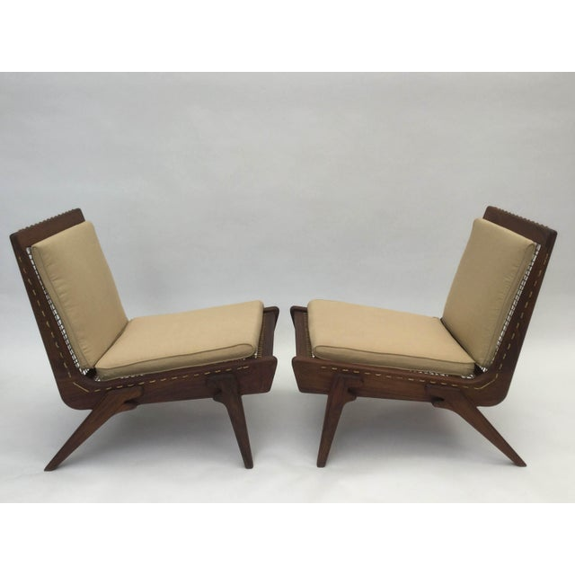 Pair of Yucatan lounge chairs made in walnut and hand spun ixtle from the maguey plant. Produced in Mexico City. Lead...