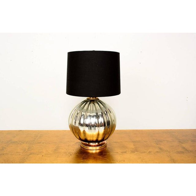 For your consideration a mercury table lamp, mounted in a metal base. The lamp has been rewired. Black shade is not...