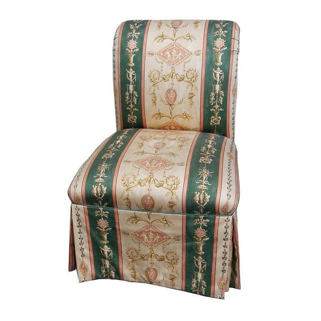 Beautifully upholstered roll back skirted slipper chair. Romantic golden, white, green and peach moire with Cherub motif ,...