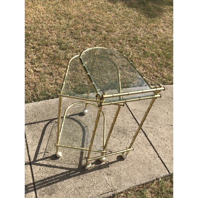 Beautiful 1960's brass plated faux bamboo bar cart with swivel service tray.