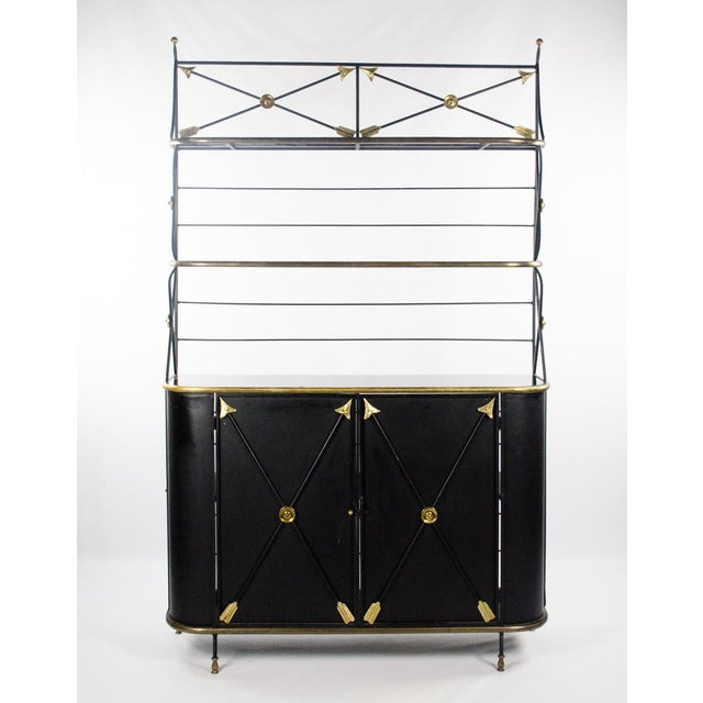 This classic mid 20th c. Modern Campaign style bakers rack and cabinet is the perfect display for bright colored plants...