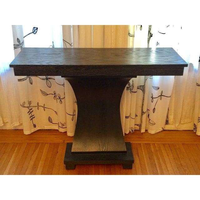 Offered is a beautiful black stained wood console with arched mid part. Great size for New York apartment!