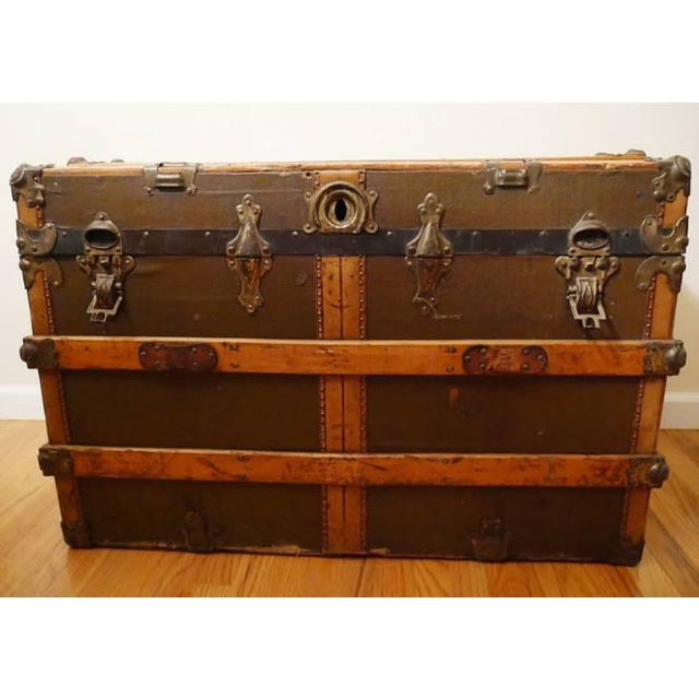 This gorgeous antique steamer trunk is all original, no mold. It has some wear/dings in accordance with age and use, two...