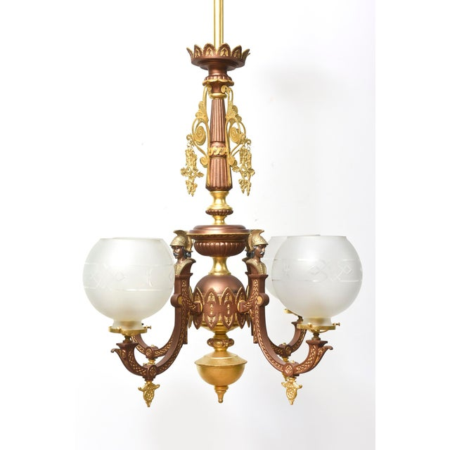 Four light Eastlake chandelier with Greek Revival influences. Each arm features the bust of General Kolokotronis, a...