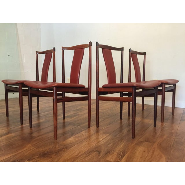 Beautiful set of 4 rosewood armchairs with original vintage brick red leather upholstery, by Henning Sorensen circa 1968....