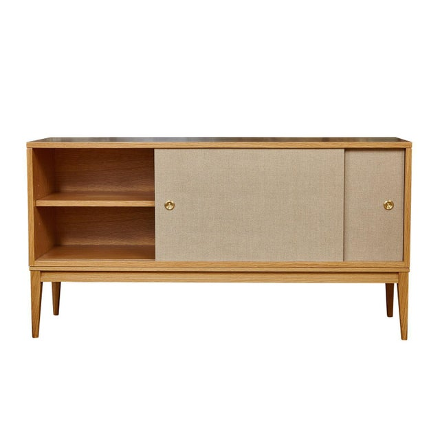 MN Originals cerused oak console on solid tapered leg base with belgium linen sliding doors detailed with solid brass...