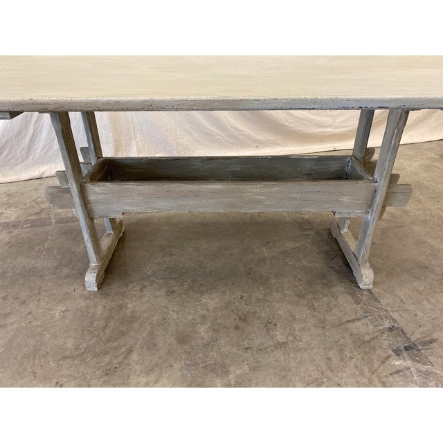 Handsome Swedish trestle dining table, made of pine, with a lovely gray distressed patina. This beautiful table has it's...