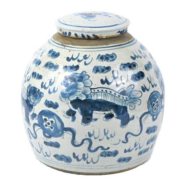 This is a beautiful large blue & white Chinese porcelain ginger jar. This large rounded jar has a unique large Foo Dog...