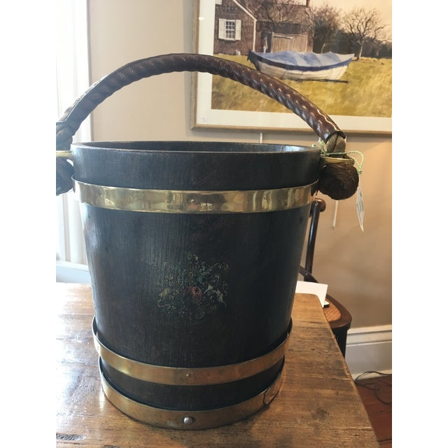 English brass and wood bucket with coat of arms and leather handle. Great for kindling, flowers, or waste basket.