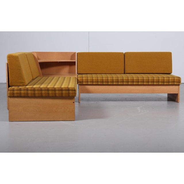'Swan' corner sofa and armchair from Ekornes, Norway, 1970s. Made of lacquered oak, each covered with checkered wool,...