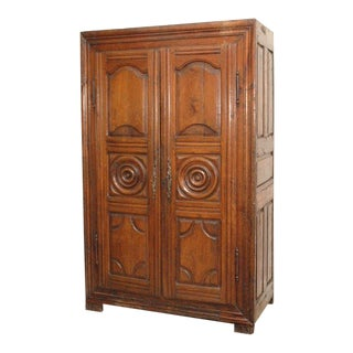 Late 18th Century French Carved Cherrywood Armoire For Sale