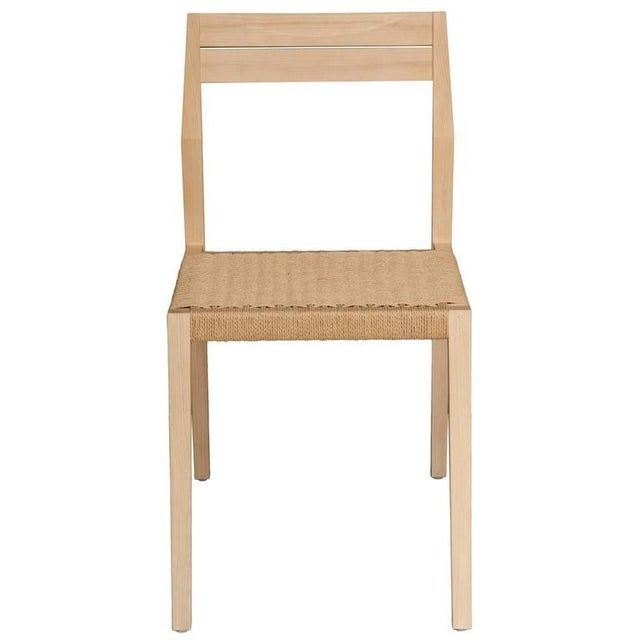 Set of ten oiled ash dining chair with paper cord seat. Designed by Paul Mignogna for Stillmade. Measures: Seat height...