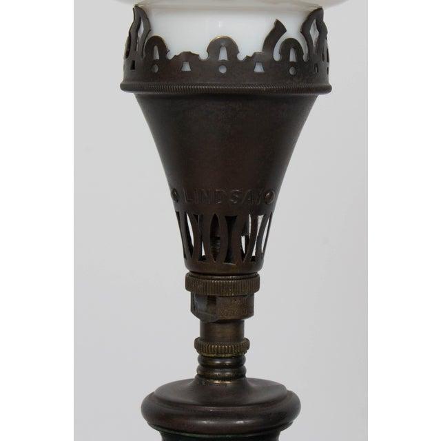 Meiji Japanese Bronze Table Lamp. Dark Patinated Bronze, relief design of a crane. Restored and rewired,bronze has been...