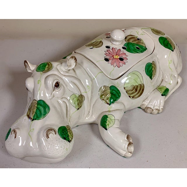 This is a large painted hippo flower frog or could be used as a serving piece. It is by Fitz and Floyd and is marked.
