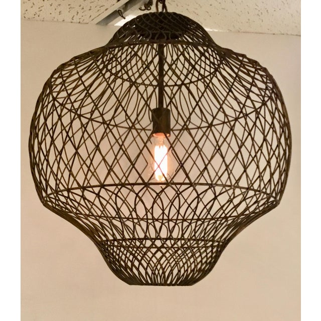 Stylish transitional Currey & Co. Trellis Iron Pendant, finished in bronze, Moroccan flare, versatile and great with an...
