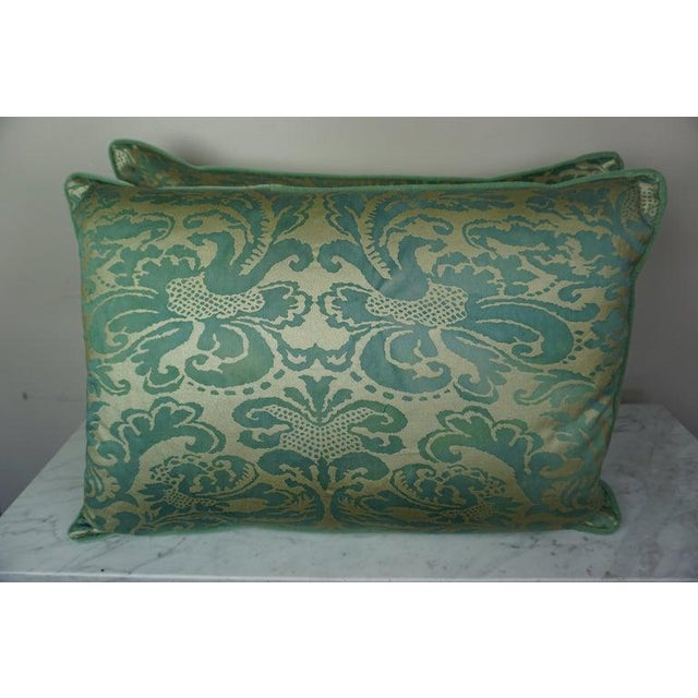 Pair of Italian style printed pillows in green and gold with green velvet backs and self cord detail. Down inserts, sewn...