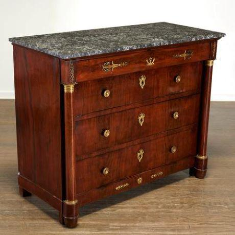 19th c., Handsome French mahogany commode with gray and white veined marble top. An ormolu-mounted frieze drawer and three...
