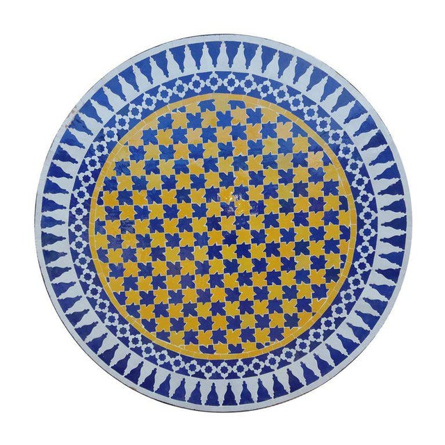 Moroccan multi-color mosaic tile table. An indoor / outdoor table of measuring approximately 48 inches in diameter....