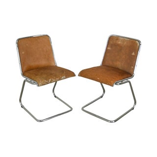Mid Century Modern Air of Tubular Chrome Cantilever Chairs W/ Tan Cowhide For Sale