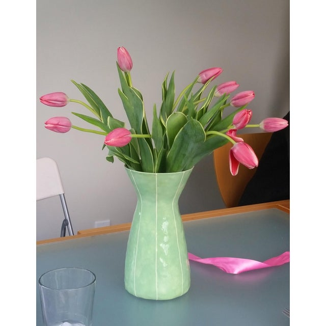 """Tall, handmade celery green ceramic vase has a tall, classic shape and thin, raised white stripe detailing. The """"Eve""""..."""