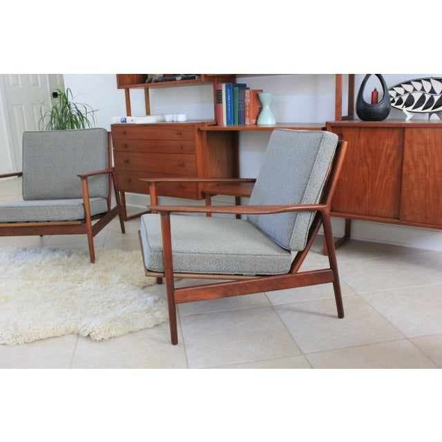 Set of 2 Danish Modern lounge chairs designed by Ib Kofod-Larsen, Model #637-15, in oiled walnut for Selig. Both chairs...