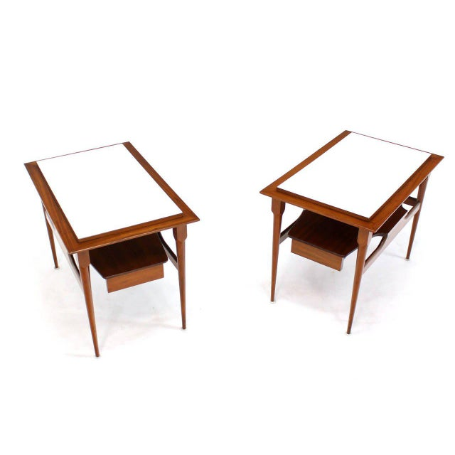 Pair of elegant mid century modern laminated top tapered legs walnut end tables.