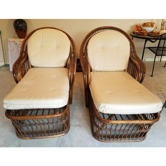 A wonderfully vintage pair of wicker/rattan chaise lounges in brown with cushion (later). Both very clean with minimal...
