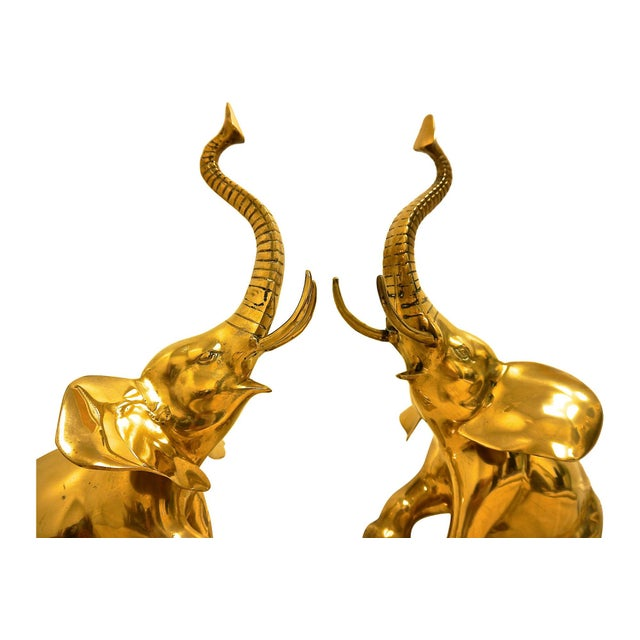 Gorgeous pair of oversized brass elephants rearing on foot pedestals. There are no maker's marks but these are estimated...