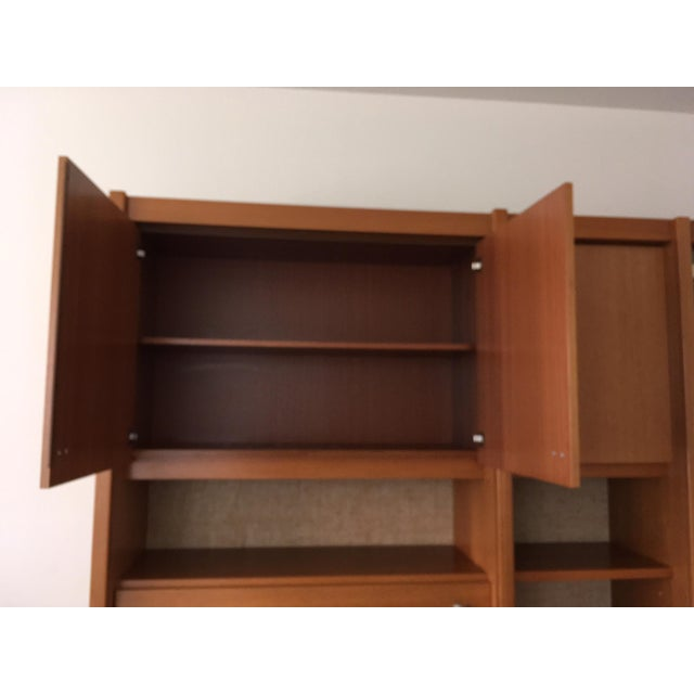 Beautiful Teak 3-piece wall system with mini bar, five cabinets, five shelves with four glass doors, five open shelves and...