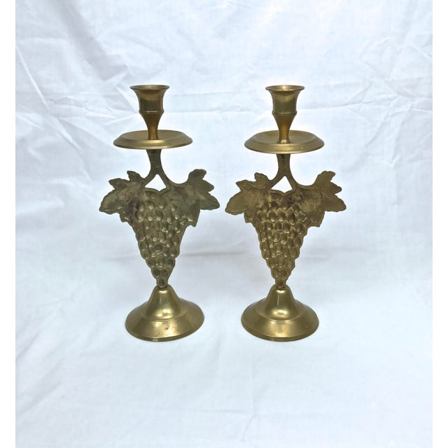 Here is a pretty unique set of grape cluster candlesticks in a heavy brass repoussé style. Made in India. Last picture...