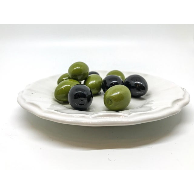 This is an Este Trompe L'Oeil ceremic art dish featuring black and green olives. This is a collectors piece that is great...
