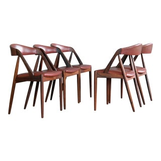 Set of Five Kai Kristiansen Rosewood and Red Leather Dining Chairs Model 31 For Sale