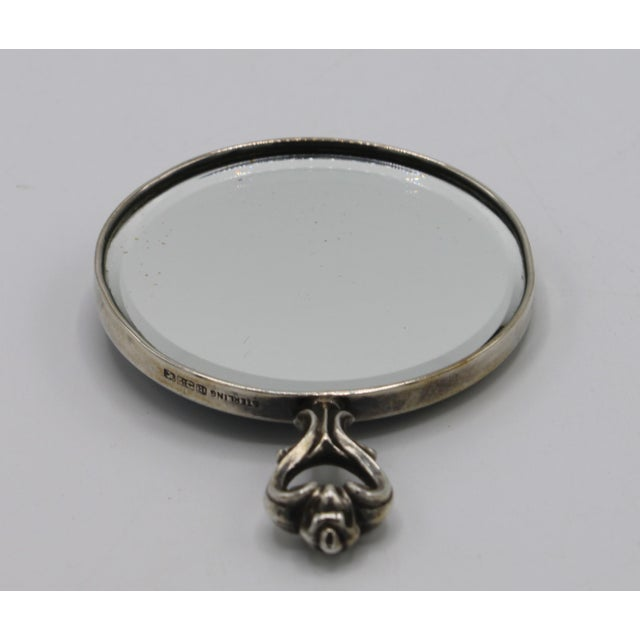A lovely antique, sterling silver purse or pocket mirror. The mirror is in excellent condition, with beveled edging. The...