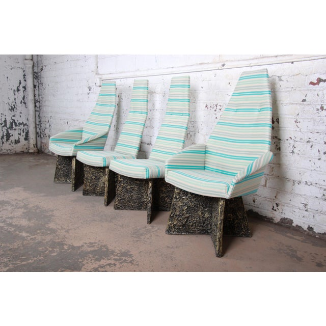 A rare and outstanding set of four mid-century modern Brutalist dining chairs designed by Adrian Pearsall. The set...