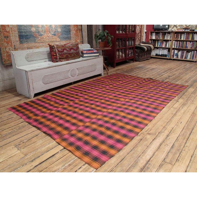 A lovely old flat-weave from Western Turkey, woven in panels on a narrow loom. It can be used as a floor cover in a low...