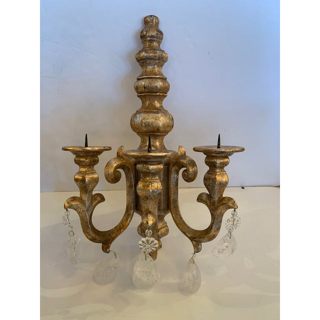 Impressive glamorous pair of chunky giltwood candle sconces dripping with large rock crystals. Note: Matching chandelier...