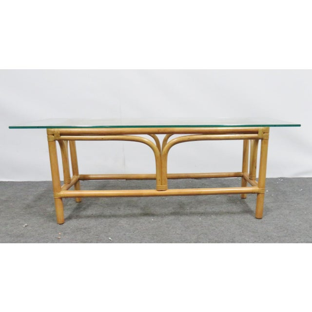 Mid century modern coffee table. Rattan with glass top